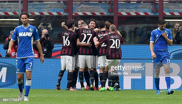Carlos Bacca of AC Milan celebrate after scoring the opening goal during the Serie A match between AC Milan and US Sassuolo Calcio at Stadio Giuseppe...