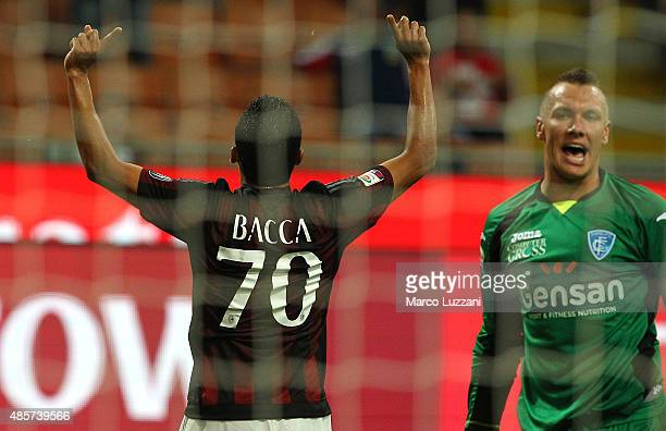 Carlos Bacca of AC Milan celebrates after scoring the opening goal during the Serie A match between AC Milan and Empoli FC at Stadio Giuseppe Meazza...