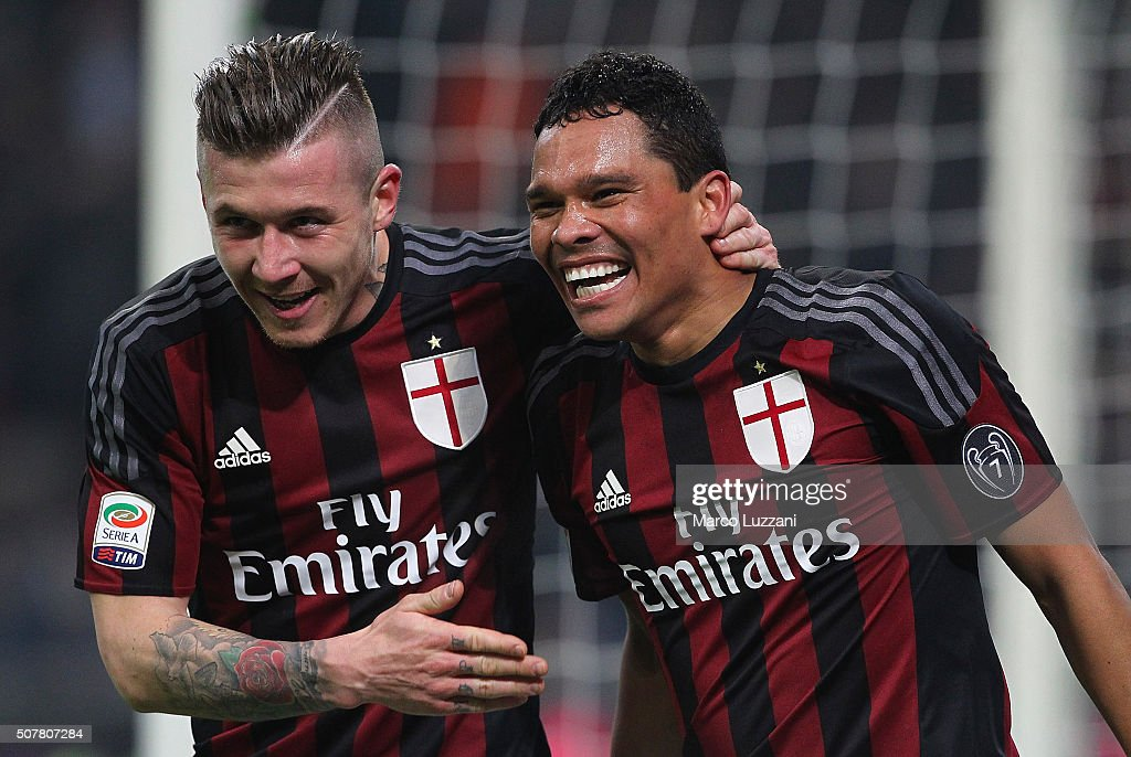 Carlos Bacca (R) of AC Milan celebrates his goal with his team-mate Juraj Kucka (L) during the Serie A match between AC Milan and FC Internazionale Milano at Stadio Giuseppe Meazza on January 31, 2016 in Milan, Italy.