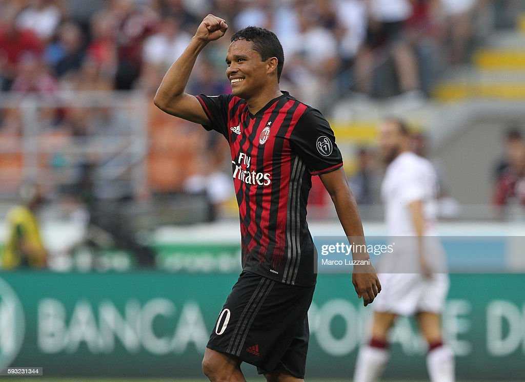 Carlos Bacca of AC Milan celebrates his second goal during the Serie A match between AC Milan and FC Torino at Stadio Giuseppe Meazza on August 21...