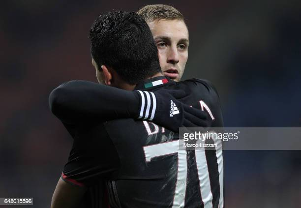 Carlos Bacca of AC Milan celebrates his second goal with his teammate Gerard Deulofeu during the Serie A match between AC Milan and AC ChievoVerona...