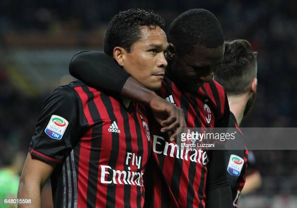 Carlos Bacca of AC Milan celebrates his second goal with his teammate Cristian Zapata during the Serie A match between AC Milan and AC ChievoVerona...