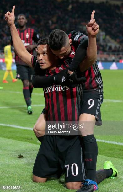 Carlos Bacca of AC Milan celebrates his second goal with his teammate Gianluca Lapadula during the Serie A match between AC Milan and AC ChievoVerona...