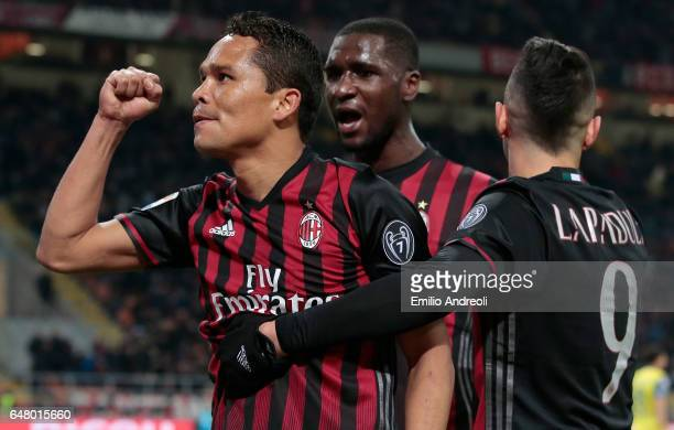 Carlos Bacca of AC Milan celebrates his second goal with his teammate Gianluca Lapadula and Cristian Zapata during the Serie A match between AC Milan...