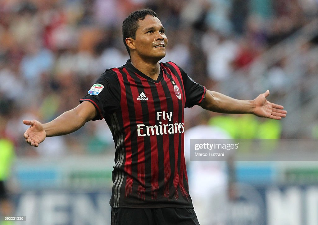 Carlos Bacca of AC Milan celebrates his third goal during the Serie A match between AC Milan and FC Torino at Stadio Giuseppe Meazza on August 21...