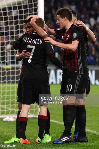 Carlos Bacca of AC Milan celebrates scoring his team's first goal to make the score 11 with his teammates during the Serie A match between Juventus...
