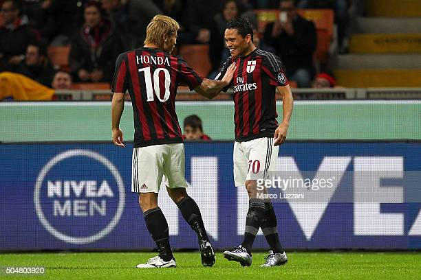 Carlos Bacca of AC Milan celebrates with his teammate Keisuke Honda after scoring the opening goal during the TIM Cup match between AC Milan and...