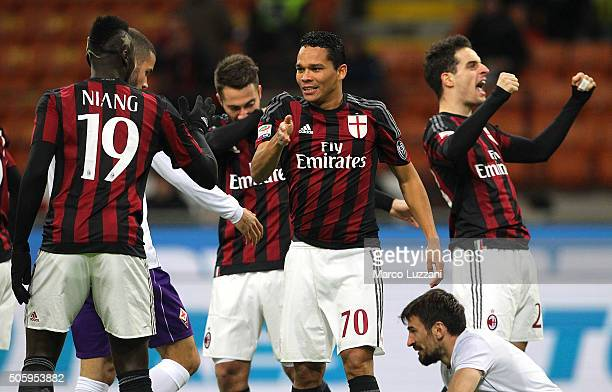 Carlos Bacca of AC Milan celebrates with his teammate M Baye Niang after scoring the opening goal during the Serie A match between AC Milan and ACF...