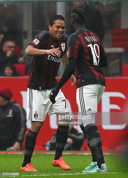 Carlos Bacca of AC Milan celebrates with his teammate M Baye Niang after scoring the opening goal during the Serie A match between AC Milan and Genoa...