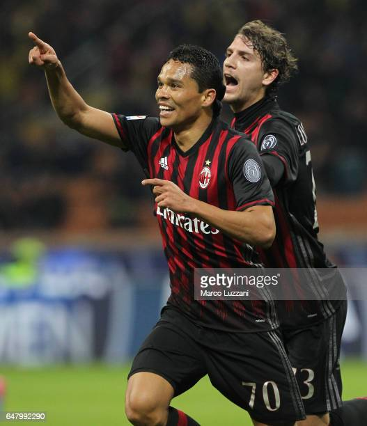 Carlos Bacca of AC Milan celebrates with his teammate Manuel Locatelli after scoring the opening goal during the Serie A match between AC Milan and...