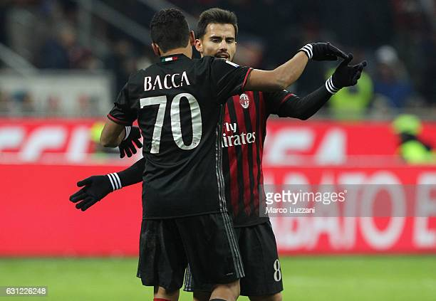 Carlos Bacca of AC Milan celebrates with his teammate Suso after scoring the opening goal during the Serie A match between AC Milan and Cagliari...