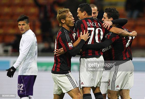 Carlos Bacca of AC Milan celebrates with his teammates Keisuke Honda and Giacomo Bonaventura after scoring the opening goal during the Serie A match...
