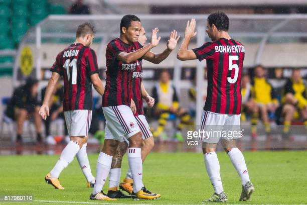 Carlos Bacca of AC Milan celebrates with team mates after scoring his team's first goal during the 2017 International Champions Cup China between AC...