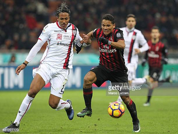 Carlos Bacca of AC Milan competes for the ball with Bruno Eduardo Alves of Cagliari Calcio during the Serie A match between AC Milan and Cagliari...