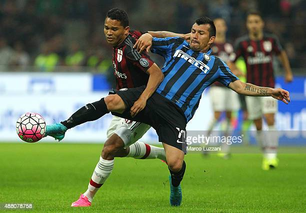 Carlos Bacca of AC Milan competes for the ball with Gary Alexis Medel of FC Internazionale Milano during the Serie A match between FC Internazionale...