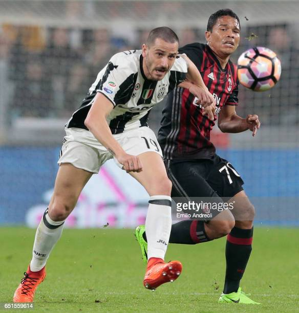 Carlos Bacca of AC Milan competes for the ball with Leonardo Bonucci of Juventus FC during the Serie A match between Juventus FC and AC Milan at...
