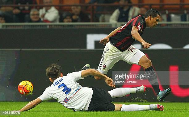 Carlos Bacca of AC Milan competes for the ball with Rafael Toloi of Atalanta BC during the Serie A match between AC Milan and Atalanta BC at Stadio...