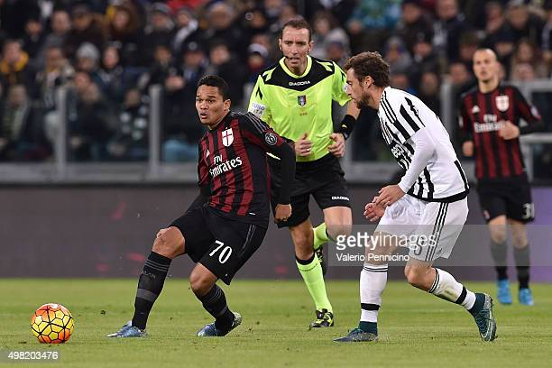 Carlos Bacca of AC Milan in action against Claudio Marchisio of Juventus FC during the Serie A match between Juventus FC and AC Milan at Juventus...