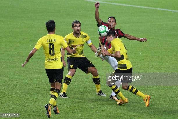Carlos Bacca of AC Milan in action against Marc Bartra Sokraits Papastathopoulus and Nuri Sahin of Dortmund during the 2017 International Champions...
