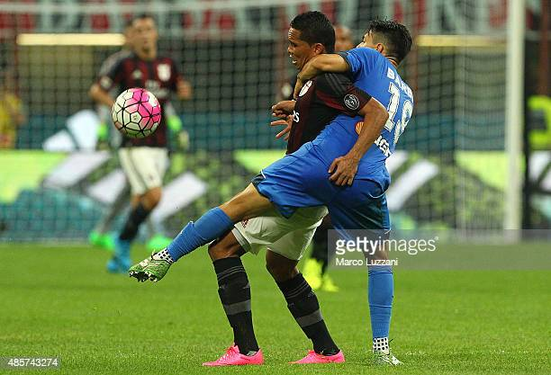 Carlos Bacca of AC Milan is challenged by Federico Barba of Empoli FC during the Serie A match between AC Milan and Empoli FC at Stadio Giuseppe...