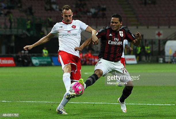 Carlos Bacca of AC Milan is challenged by Massimo Volta of AC Perugia during the TIM Cup match between AC Milan and AC Perugia at Stadio Giuseppe...