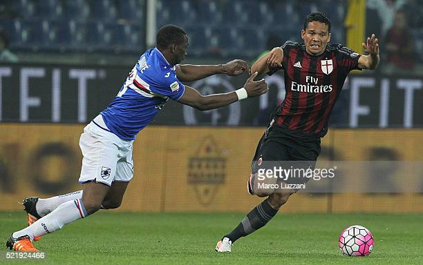 Carlos Bacca of AC Milan is challenged by Modibo Diakite of UC Sampdoria during the Serie A match between UC Sampdoria and AC Milan at Stadio Luigi...