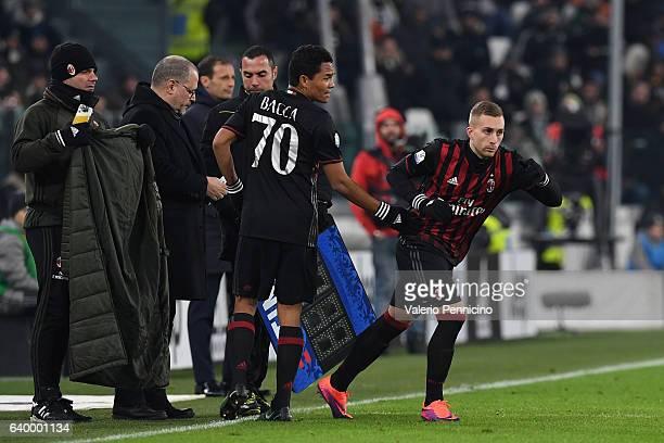 Carlos Bacca of AC Milan is replaced by Gerard Deulofeu during the TIM Cup match between Juventus FC and AC Milan at Juventus Stadium on January 25...