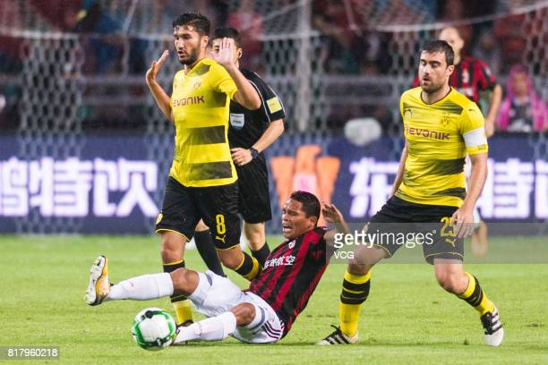 Carlos Bacca of AC Milan Nuri Sahin and Sokratis Papastathopoulos of Borussia Dortmund compete for the ball during the 2017 International Champions...