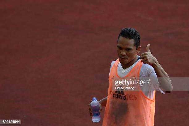 Carlos Bacca of AC Milan reacts to fans after duirng training session ahead of the 2017 International Champions Cup football match between AC milan...