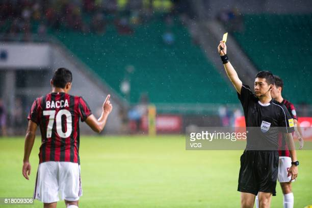 Carlos Bacca of AC Milan receives a yellow card from the referee during the 2017 International Champions Cup China between AC Milan and Borussia...