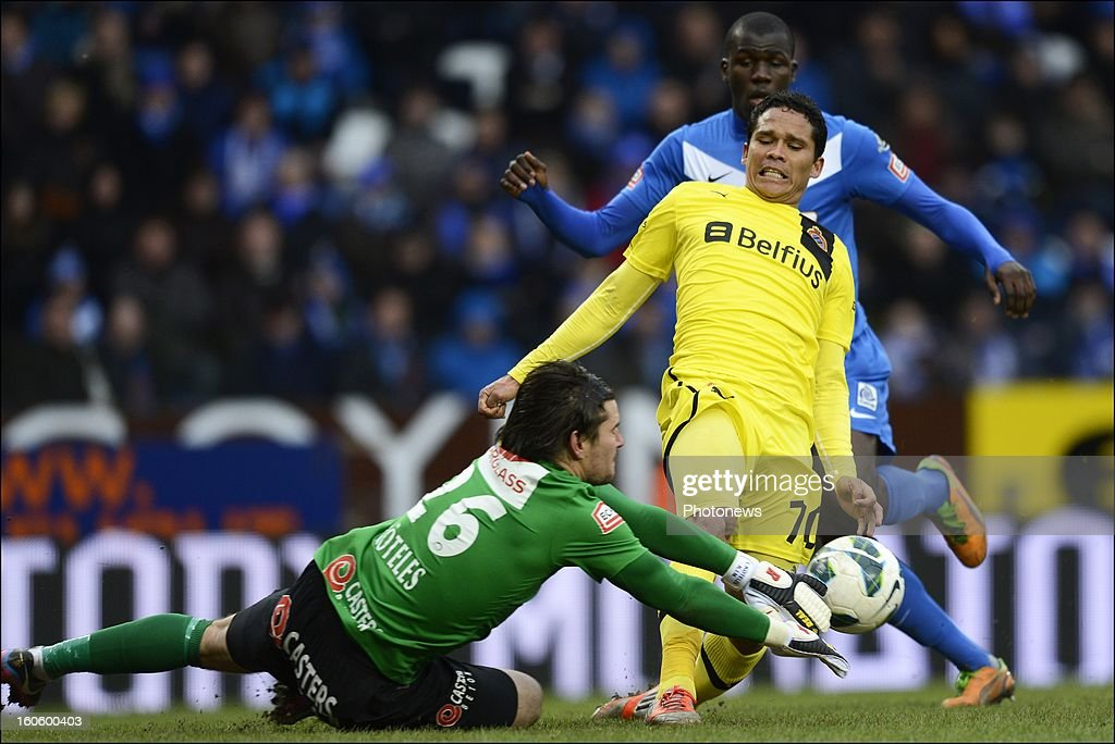 Carlos Bacca of Club Brugge KV battles for the ball with Laszlo Koteles of KRC Genk during the Jupiler League match between KRC Genk and Club Brugge KV on February 3, 2013 in Genk, Belgium.