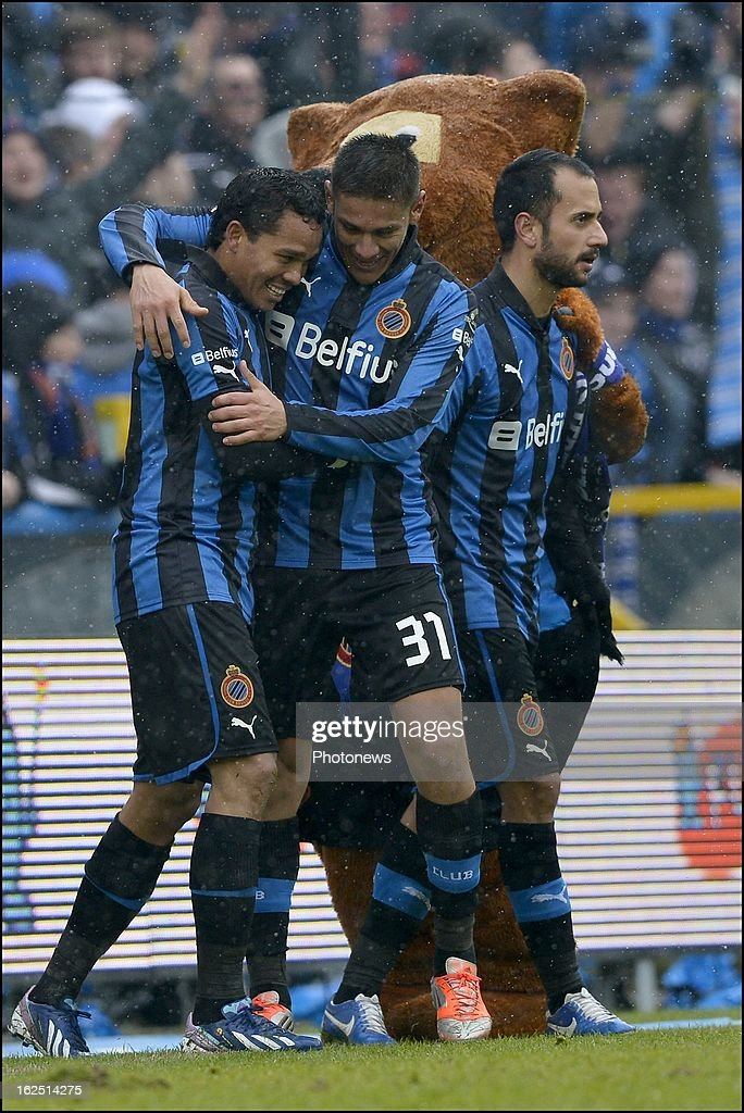 Carlos Bacca of Club Brugge KV celebrates scoring a goal with teammate Oscar Duarte of CLub Brugge KV during the Jupiler League match between Club Brugge and RSC Anderlecht on February 24, 2013 in the Jan Breydel Stadium in Brugge, Belgium.