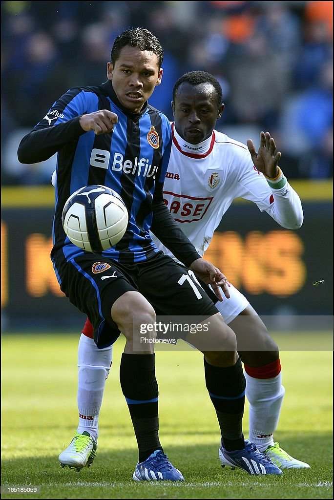 Carlos Bacca of Club Brugge KV in front of Zie Diabate of Standard during the Jupiler League match between Club Brugge and Standard de Liege on April 01, 2013 in the Jan Breydel Stadium in Brugge, Belgium.