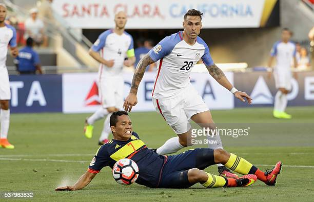 Carlos Bacca of Colombia and Geoff Cameron of United States go for the ball during the 2016 Copa America Centenario Group match between the United...