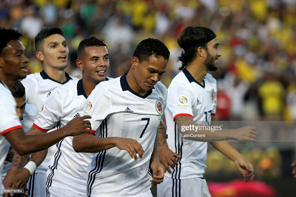 Carlos Bacca of Colombia celebrate with teamamtes after scoring the opening goal during a group A match between Colombia and Paraguay at Rose Bowl...