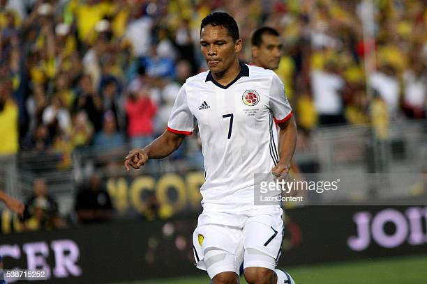 Carlos Bacca of Colombia celebrates after scoring the opening goal during a group A match between Colombia and Paraguay at Rose Bowl Stadium as part...