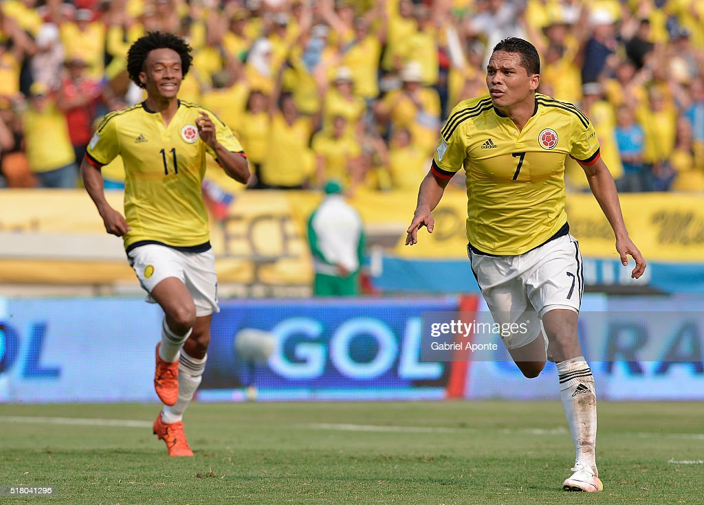 <a gi-track='captionPersonalityLinkClicked' href=/galleries/search?phrase=Carlos+Bacca&family=editorial&specificpeople=6724246 ng-click='$event.stopPropagation()'>Carlos Bacca</a> of Colombia celebrates with Juan Cuadrado after scoring the opening goal during a match between Colombia and Ecuador as part of FIFA 2018 World Cup Qualifiers at Roberto Melendez Stadium on March 29, 2016 in Barranquilla, Colombia.
