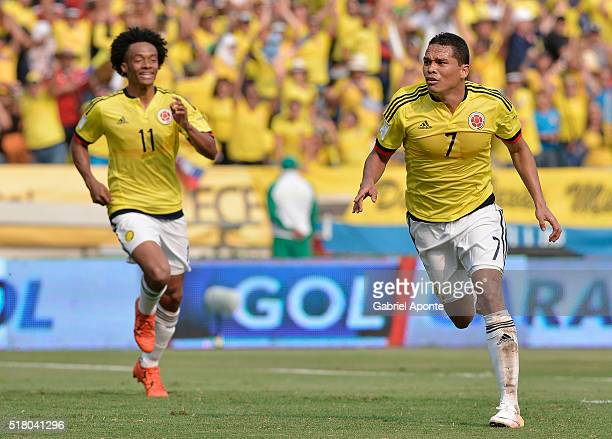 Carlos Bacca of Colombia celebrates with Juan Cuadrado after scoring the opening goal during a match between Colombia and Ecuador as part of FIFA...