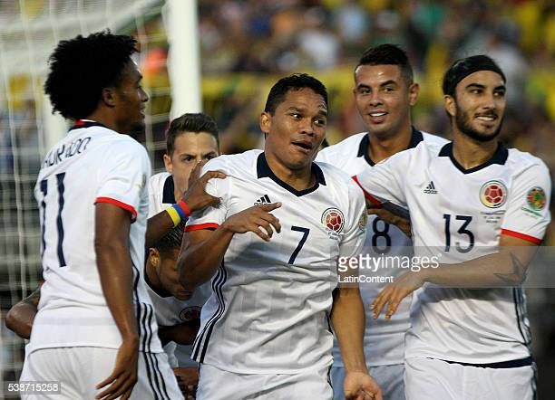 Carlos Bacca of Colombia celebrates with teamamtes after scoring the opening goal during a group A match between Colombia and Paraguay at Rose Bowl...