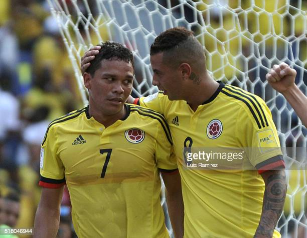 Carlos Bacca of Colombia celebrates with teammate Edwin Cardona after scoring the opening goal during a match between Colombia and Ecuador as part of...