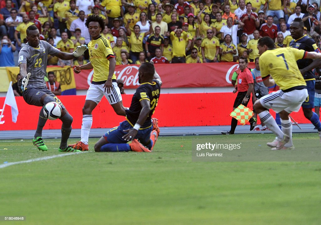 Carlos Bacca of Colombia shoots to score the opening goal during a match between Colombia and Ecuador as part of FIFA 2018 World Cup Qualifiers at...