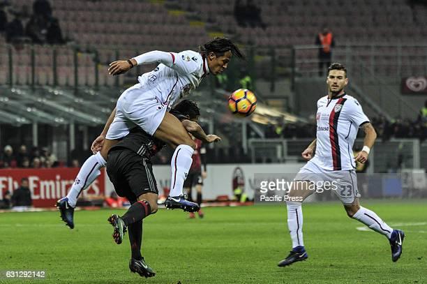 Carlos Bacca of Milan and Bruno Alves of Cagliari in action during Serie A football AC Milan versus Cagliari Milan wins against Cagliari 10