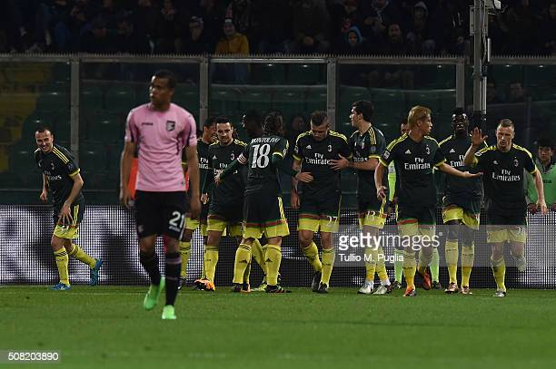 Carlos Bacca of Milan celebrates with team mates after scoring the opening goal during the Serie A match between US Citta di Palermo and AC Milan at...