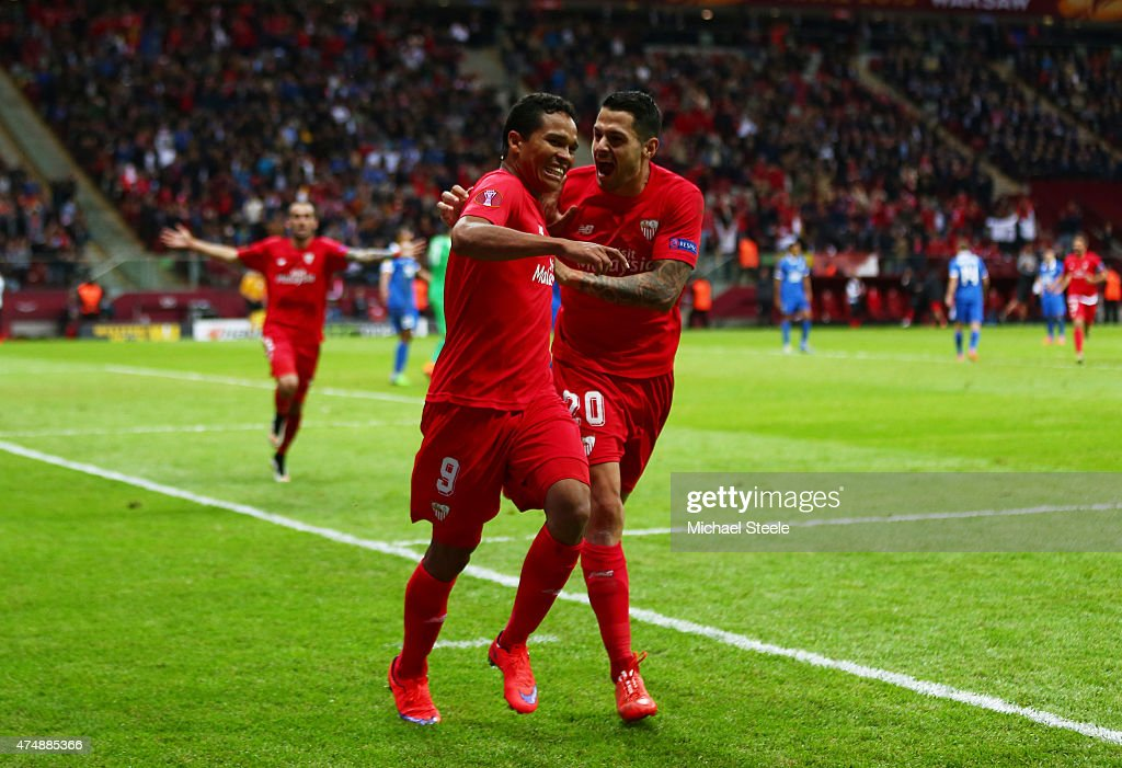 Carlos Bacca of Sevilla celebrates scoring his team's third goal with Vitolo of Sevilla during the UEFA Europa League Final match between FC Dnipro...