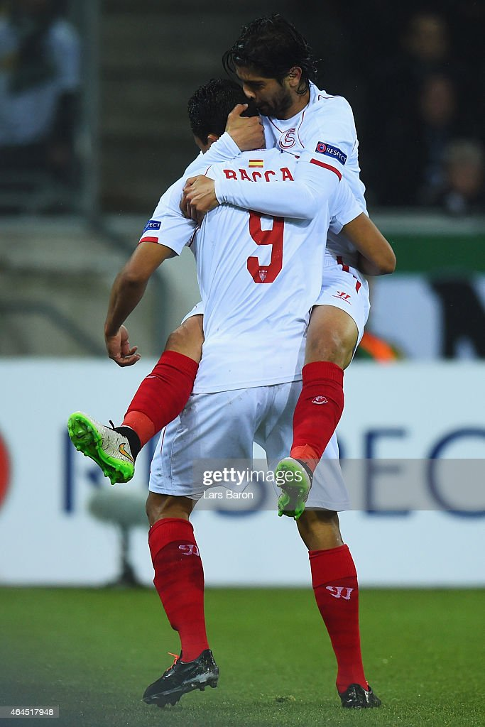 Carlos Bacca of Sevilla celebrates with Fabian Johnson as he scores their first goal during the UEFA Europa League Round of 32 second leg match...