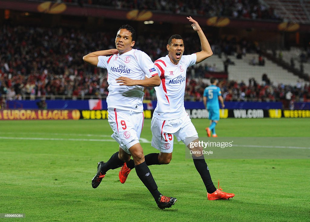 <a gi-track='captionPersonalityLinkClicked' href=/galleries/search?phrase=Carlos+Bacca&family=editorial&specificpeople=6724246 ng-click='$event.stopPropagation()'>Carlos Bacca</a> of Sevilla (9) celebrates with Timothee Kolodziejczak (15) as as he scores their first goal during the UEFA Europa League Quarter Final first leg match between FC Sevilla and FC Zenit at Estadio Ramon Sanchez Pizjuan on April 16, 2015 in Seville, Spain.