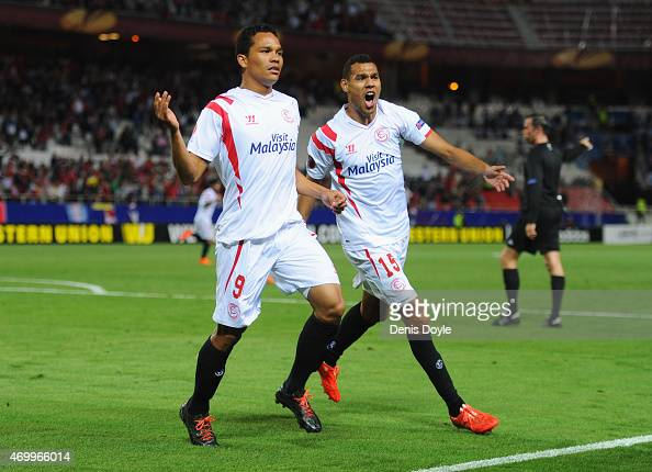 Carlos Bacca of Sevilla celebrates with Timothee Kolodziejczak as he scores their first goal during the UEFA Europa League Quarter Final first leg...