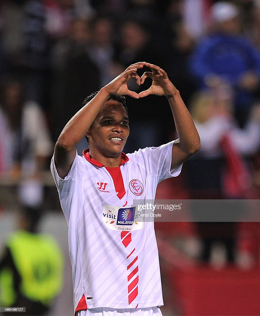 <a gi-track='captionPersonalityLinkClicked' href=/galleries/search?phrase=Carlos+Bacca&family=editorial&specificpeople=6724246 ng-click='$event.stopPropagation()'>Carlos Bacca</a> of Sevilla FC celebrates after scoring Sevilla's 2nd goal during the UEFA Europa League Semi Final first leg match between Sevilla FC and Valencia CF at Estadio Ramon Sanchez Pizjuan on April 24, 2014 in Seville, Spain.