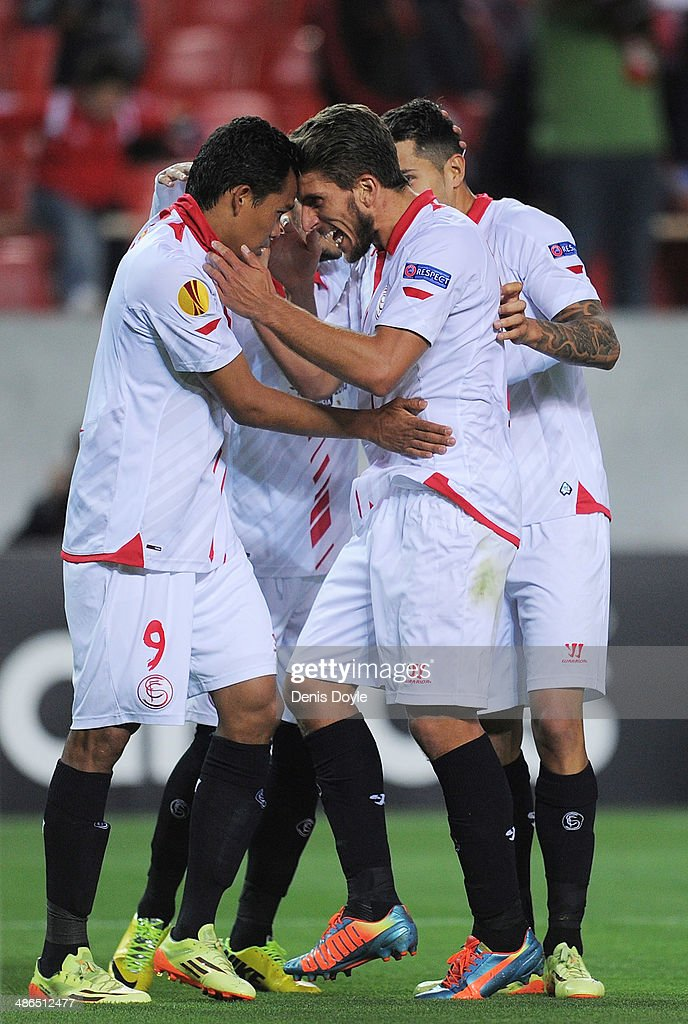 <a gi-track='captionPersonalityLinkClicked' href=/galleries/search?phrase=Carlos+Bacca&family=editorial&specificpeople=6724246 ng-click='$event.stopPropagation()'>Carlos Bacca</a> (L) of Sevilla FC celebrates with Daniel Carrico after scoring Sevilla's 2nd goal during the UEFA Europa League Semi Final first leg match between Sevilla FC and Valencia CF at Estadio Ramon Sanchez Pizjuan on April 24, 2014 in Seville, Spain.