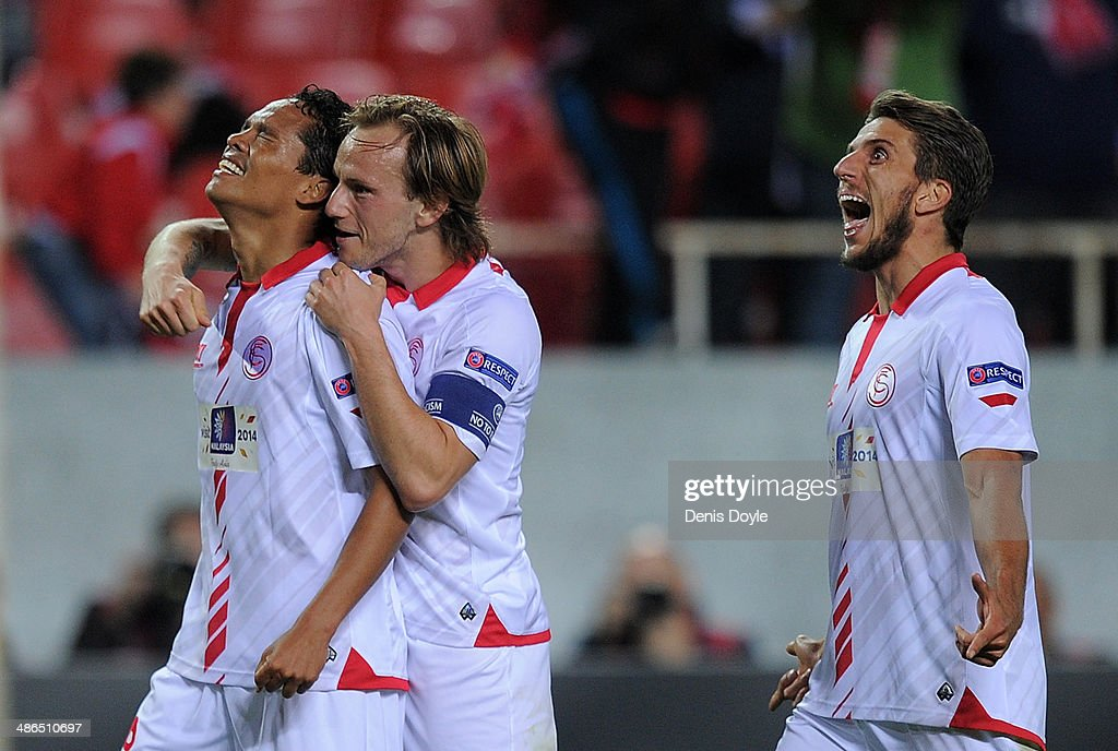 <a gi-track='captionPersonalityLinkClicked' href=/galleries/search?phrase=Carlos+Bacca&family=editorial&specificpeople=6724246 ng-click='$event.stopPropagation()'>Carlos Bacca</a> (L) of Sevilla FC celebrates with <a gi-track='captionPersonalityLinkClicked' href=/galleries/search?phrase=Ivan+Rakitic&family=editorial&specificpeople=3987920 ng-click='$event.stopPropagation()'>Ivan Rakitic</a> and Daniel Carrico after scoring Sevilla's 2nd goal during the UEFA Europa League Semi Final first leg match between Sevilla FC and Valencia CF at Estadio Ramon Sanchez Pizjuan on April 24, 2014 in Seville, Spain.